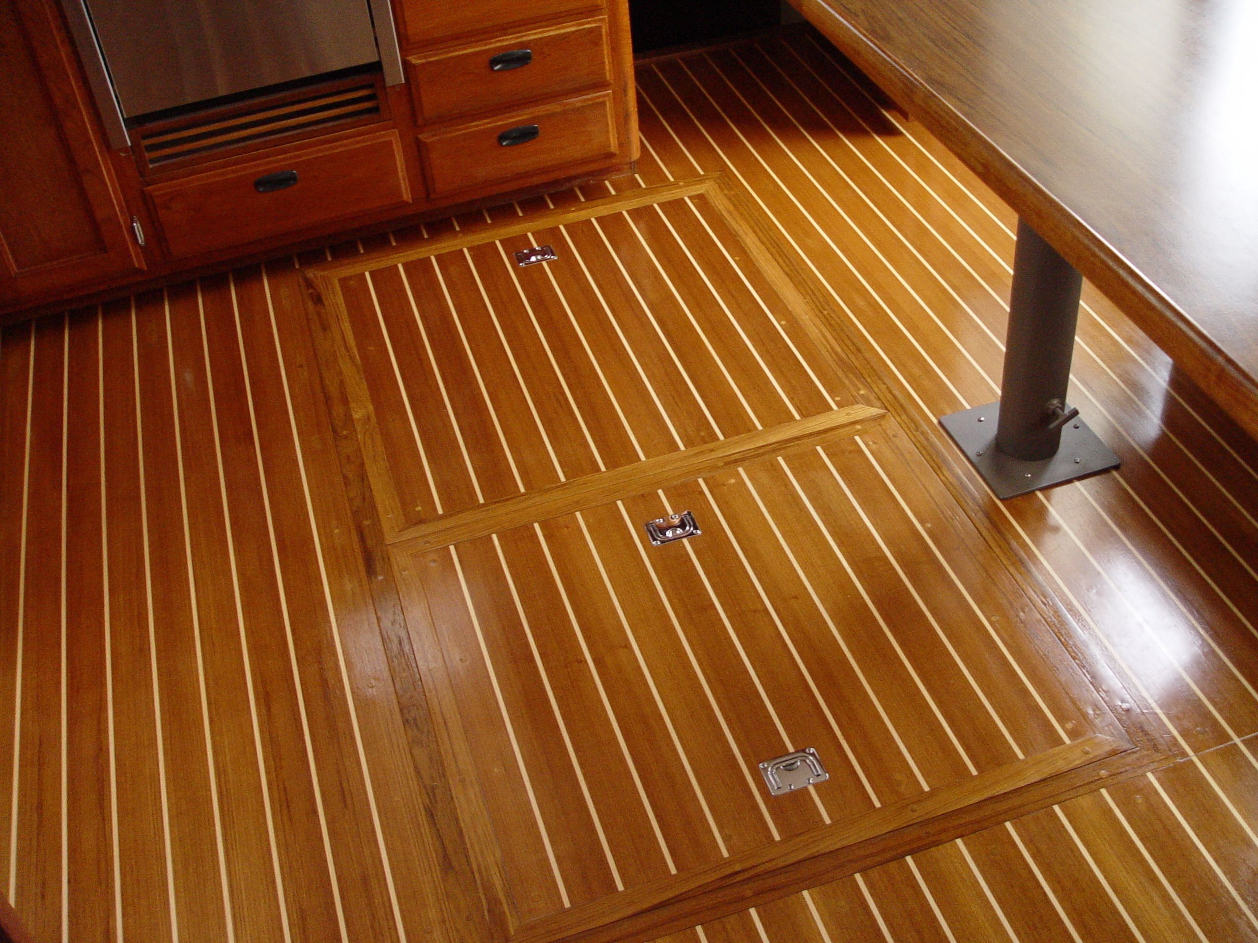New galley teak-and-holly floors